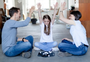 Young family is playing board-game